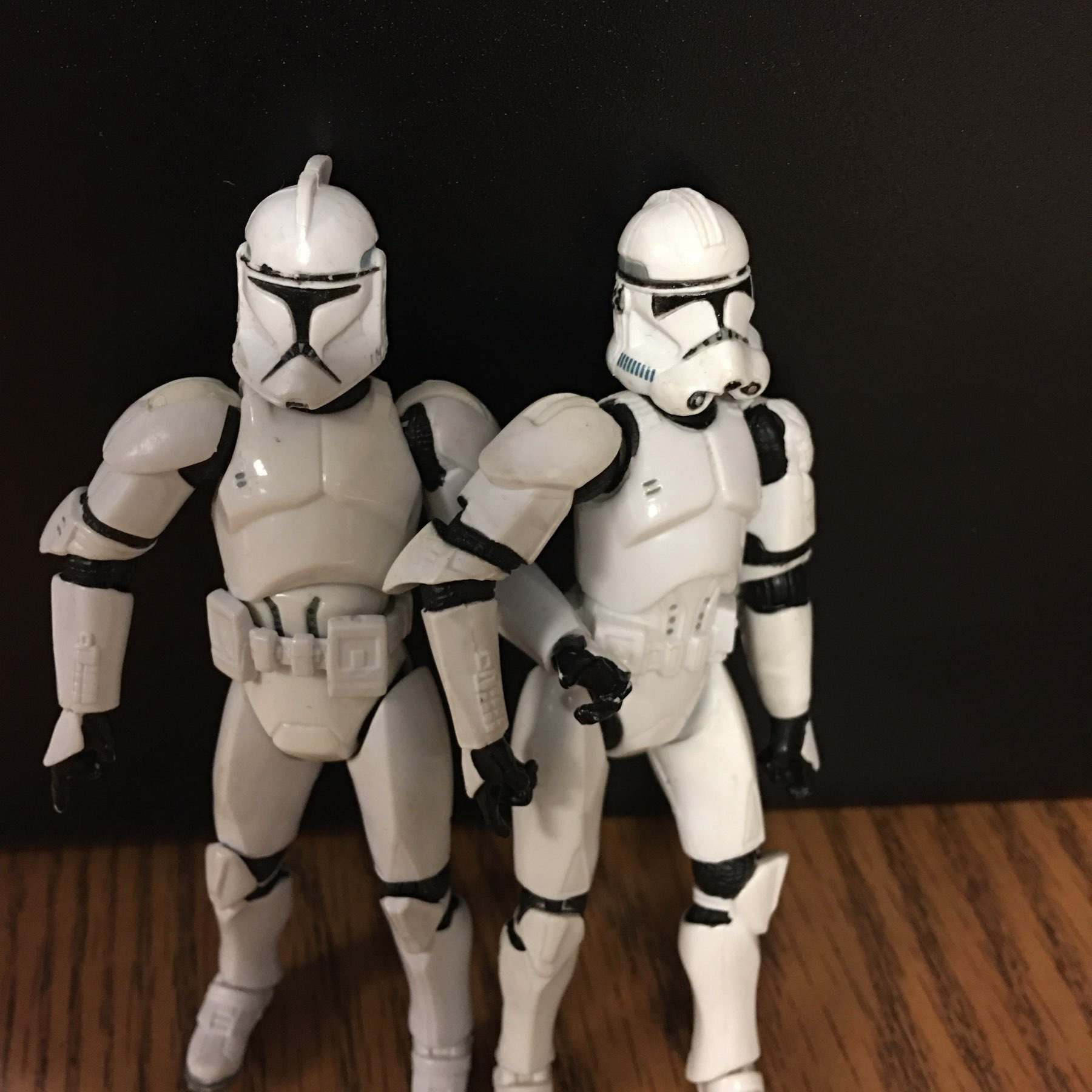 Two storm troopers holding hands.