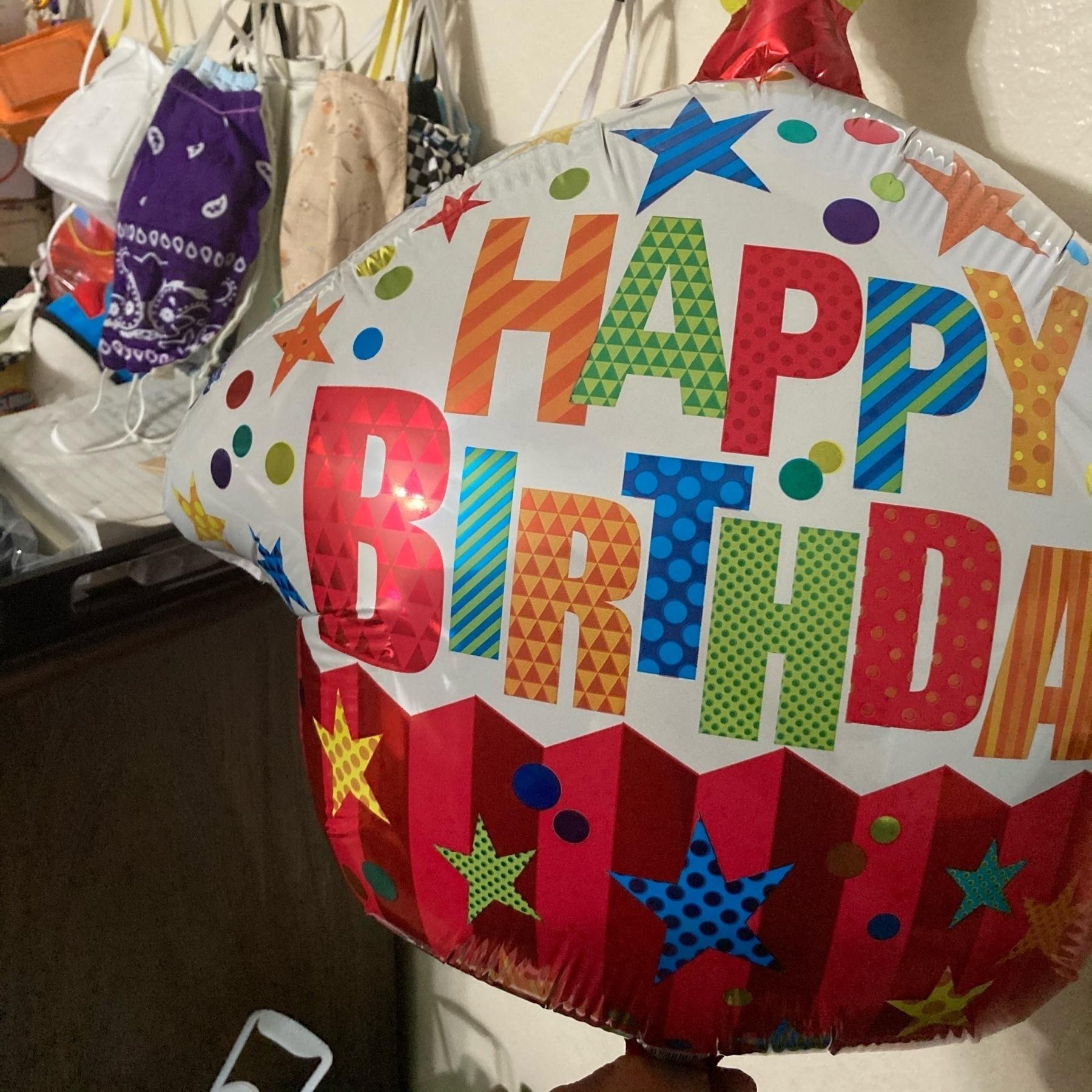 Birthday ballon next to masks.