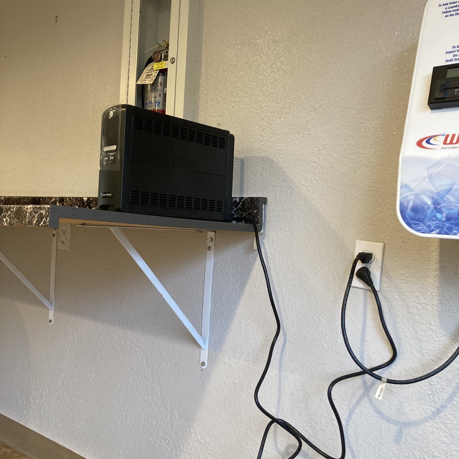 UPS plugged into the wall.