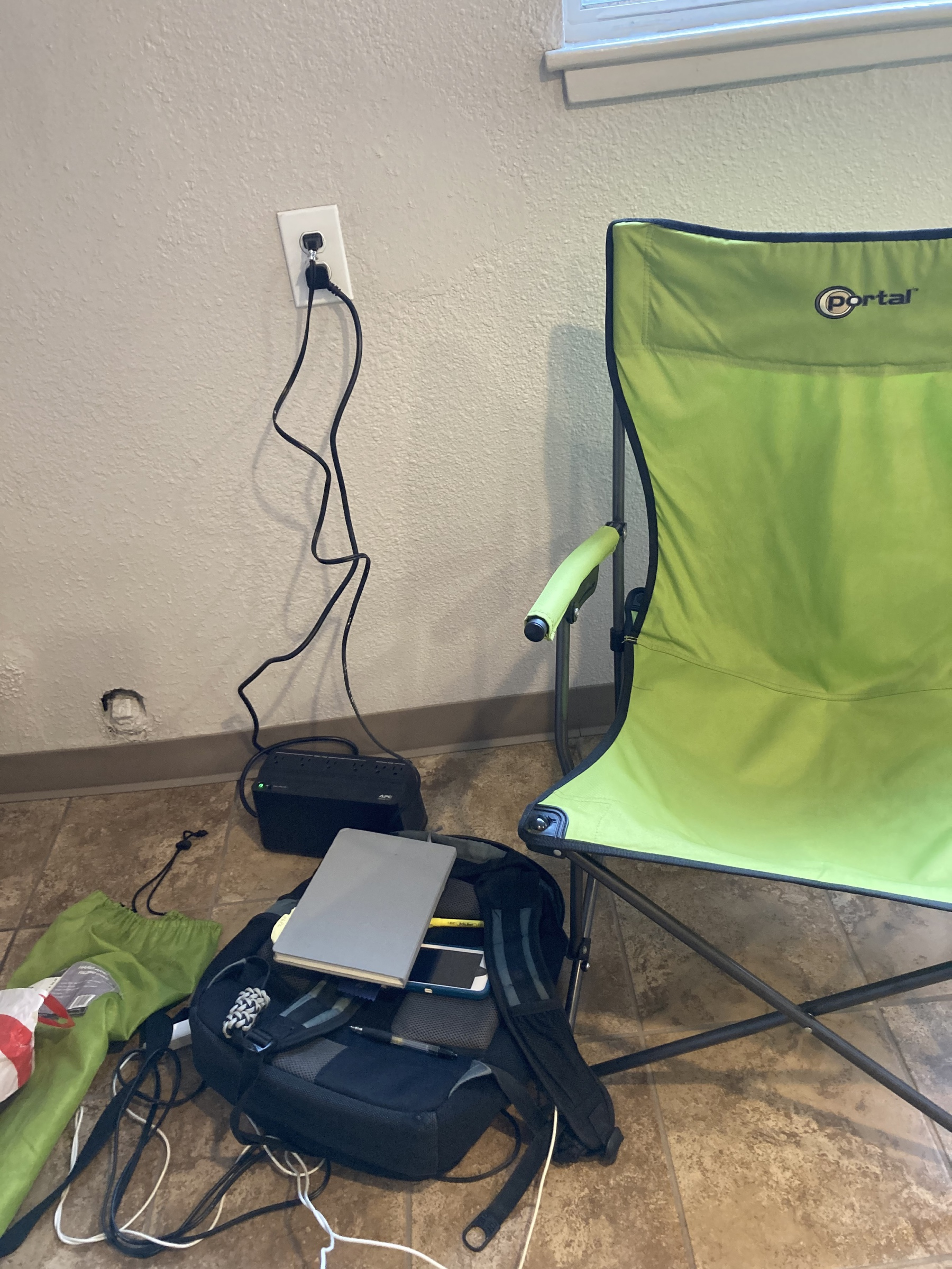 A chair next to iPhones being charged.