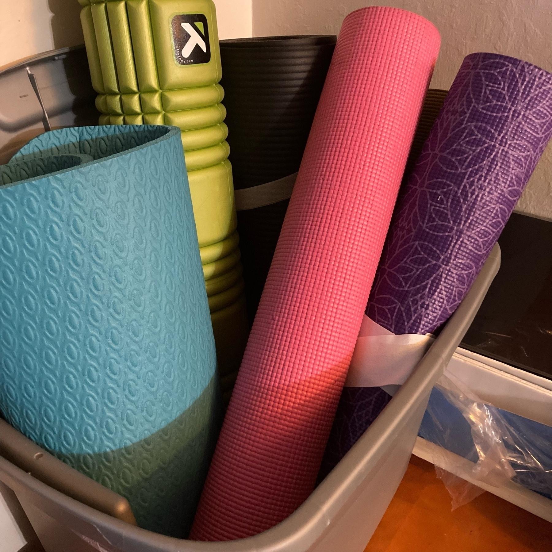 Yoga mats in a bin.